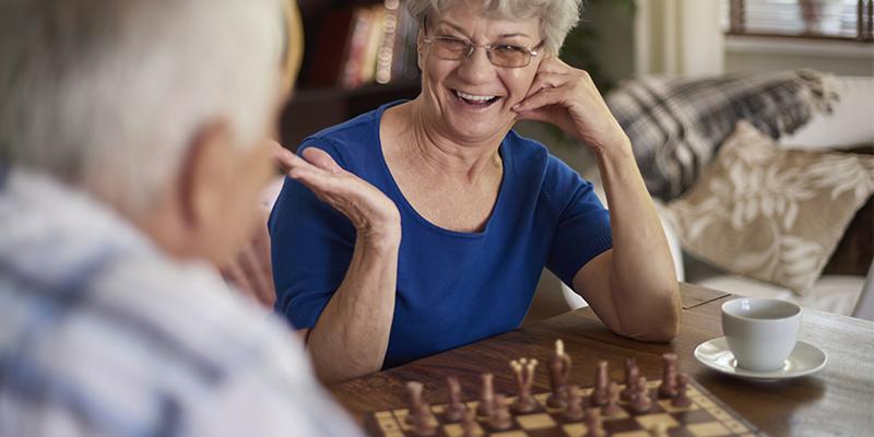Grandmother playing chess