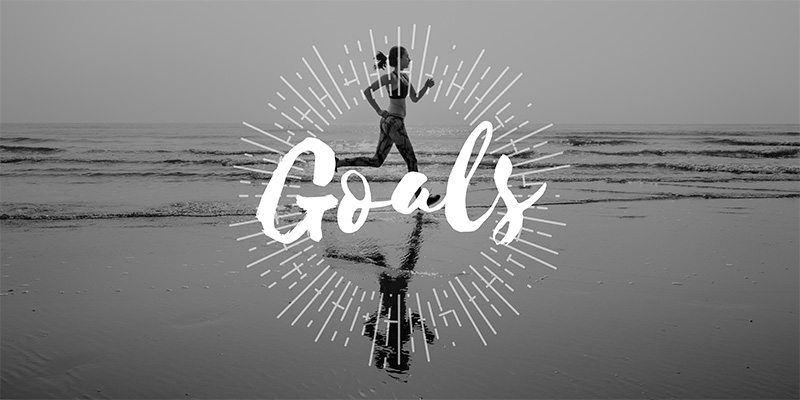 Goals text graphic with girl running background